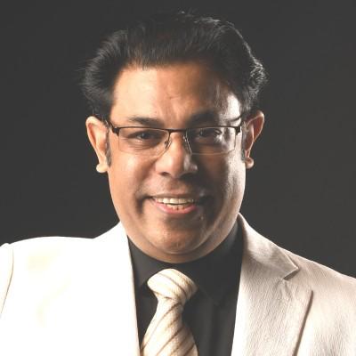 Dr Raman K. Attri